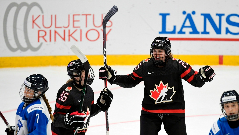 Goal scorer Loren Gabel, centre left, and Emily Clark of Canada celebrate the game's opening goal, during the IIHF Women's Hockey World Championships Group A match between Canada and Finland in Espoo, Finland, Tuesday, April 9, 2019. (Antti Aimo-Koivisto/Lehtikuva via AP)