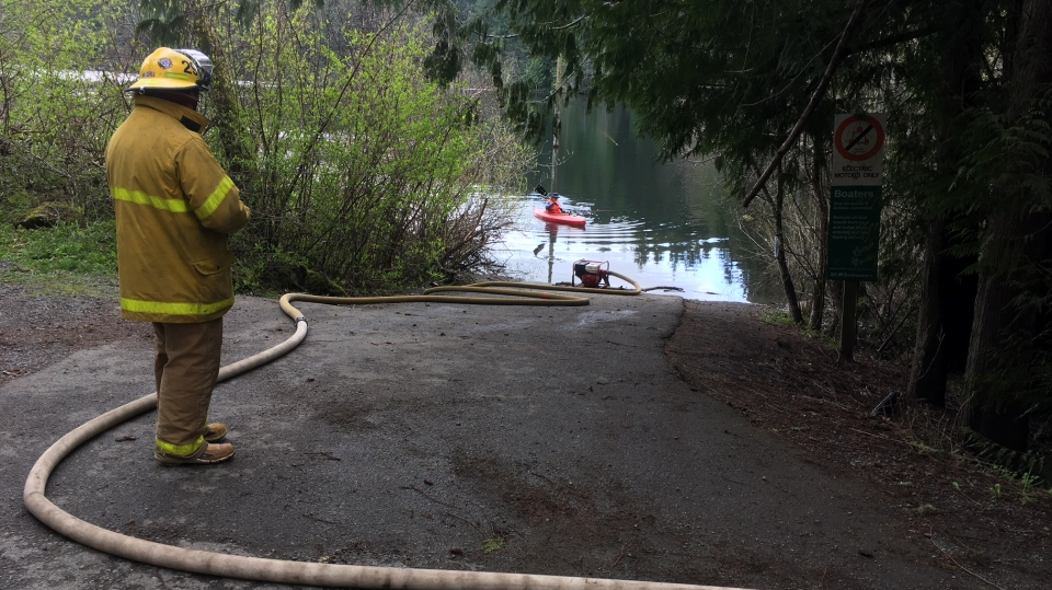 Fire crews pump water from Durrance Lake April 9, 2019. (CTV Vancouver Island)