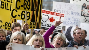 Pro-pipline supporters rally outside a public hearing of the Senate Committee on Energy, the Environment and Natural Resources regarding Bill C-69 in Calgary, Alta., Tuesday, April 9, 2019.THE CANADIAN PRESS/Jeff McIntosh