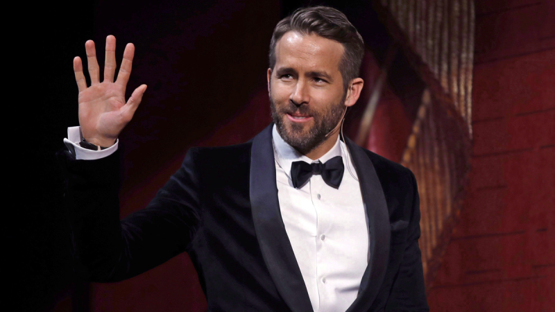 Actor Ryan Reynolds waves as he is introduced during a roast at Harvard University in Cambridge, Mass., Friday, Feb. 3, 2017. (AP / Charles Krupa)