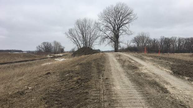 Dirt piles in place in case rail lines need protec