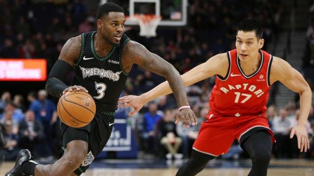 da5cc3ebd879 Minnesota Timberwolves  Jared Terrell controls the ball around Toronto  Raptors  Jeremy Lin in the first half of an NBA basketball game Tuesday  April 9