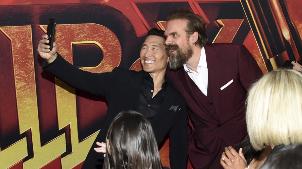 Actors Daniel Dae Kim, left, and David Harbour take a selfie at a special screening of 'Hellboy' in New York, on April 9, 2019. (Evan Agostini / Invision / AP)