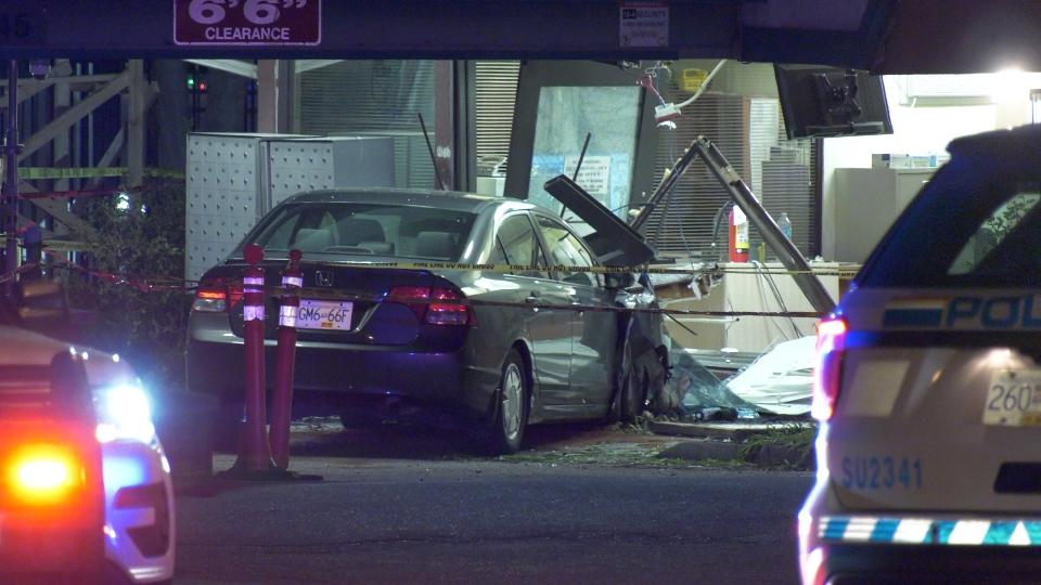 Car crashes into building in Surrey