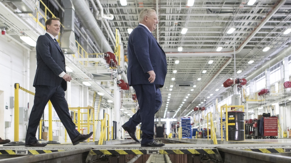 Ontario Premier Doug Ford, right, and Jeff Yurek, Provincial Minister of Transportation, make their way to a photo opportunity ahead of an announcement about Ontario's transit network, in Toronto on Wednesday, April, 10, 2019. THE CANADIAN PRESS/Chris Young