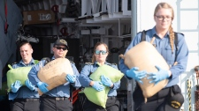 Crew members of the HMCS Regina seize a large quantity of hashish in the Indian Ocean on April 6, 2019. (Department of National Defence)