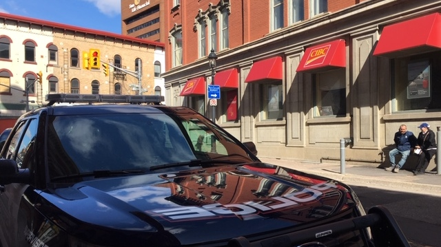 A police cruiser in front of the CIBC in downtown Kitchener. (Terry Kelly / CTV Kitchener)
