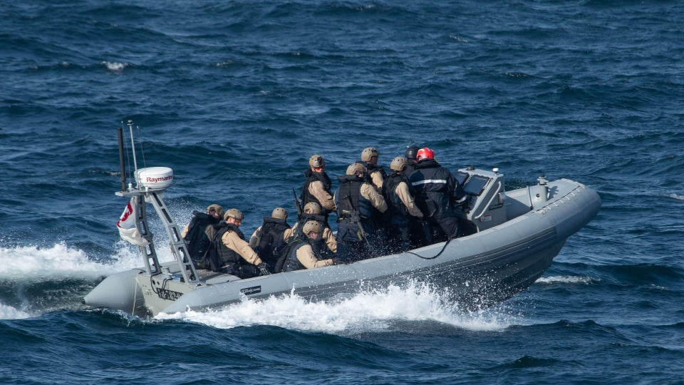 Members of the Naval Tactical Operations Group prepare to board a foreign vessel and seize narcotics  in the Indian Ocean on April 6, 2019. (Department of National Defence)