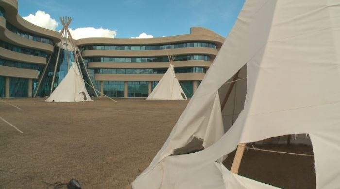 Twp tipis in front of the First Nations University have been vandalized.