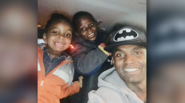 Paul Njoroge is pictured with two of his children.