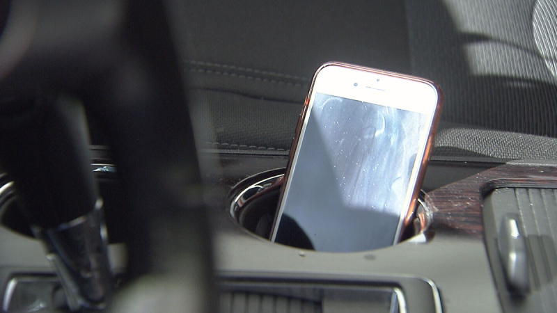 A smartphone is seen in a vehicle in this undated file photo.