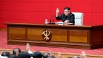 In this Wednesday, April 10, 2019, photo provided by the North Korean government, North Korean leader Kim Jong Un, background, attends the 4th Plenary Meeting of the 7th Central Committee of the Workers' Party of Korea in Pyongyang, North Korea. (Korean Central News Agency/Korea News Service via AP)