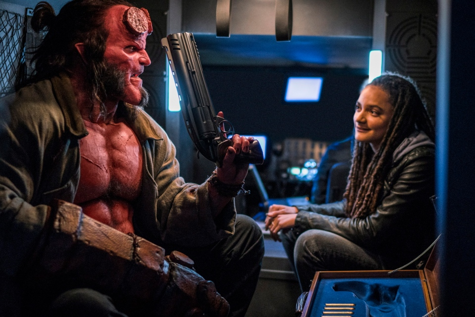 "This image released by Lionsgate shows David Harbour, left, and Sasha Lane in a scene from ""Hellboy."" (Mark Rogers/Lionsgate via AP)"