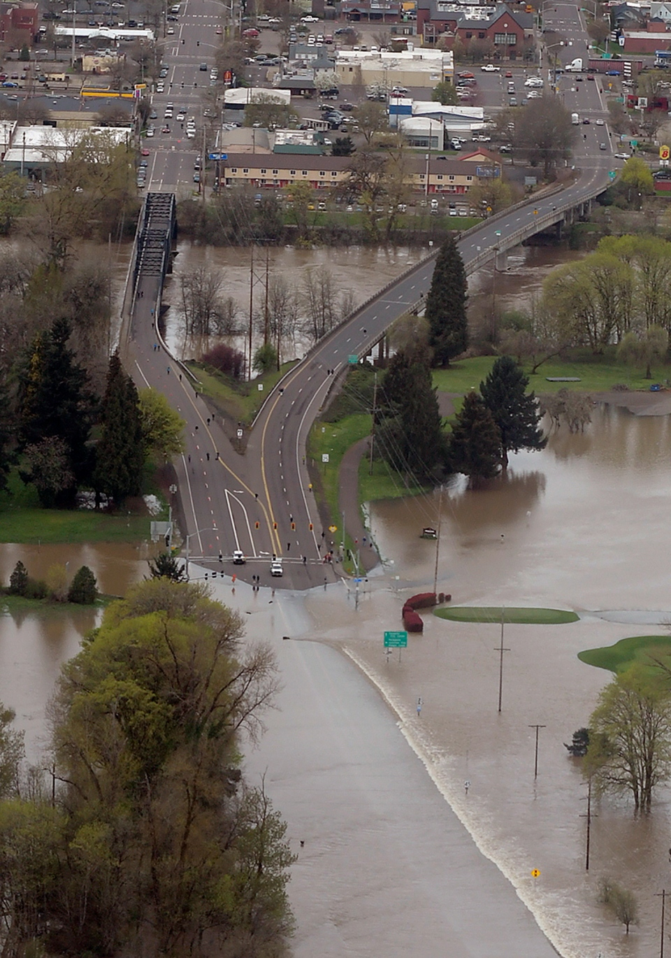 This aerial photo shows the Willamette River shutting down Highway 34 in Corvallis, Ore., Wednesday, April 10, 2019. The flooding has forced evacuations for the second day throughout parts of Oregon. (Mark Ylen/Albany Democrat-Herald via AP)