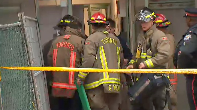 Firefighters at a building on Simcoe Street downtown where a man with a scooter fell down an elevator shaft on April 11, 2019.
