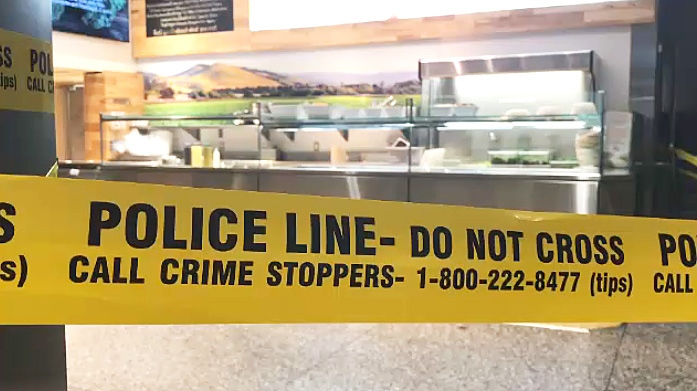 Police tape surrounds a food counter in the PATH system where a woman was murdered on April 10, 2019.