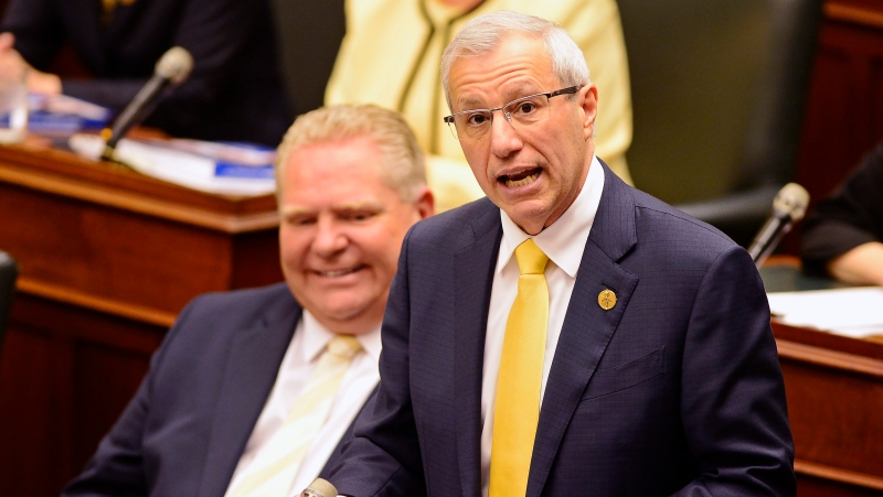 Ontario Finance Minister Vic Fedeli presents the 2019 budget as Premier Doug Ford looks on at the legislature in Toronto on Thursday, April 11, 2019. (THE CANADIAN PRESS/Frank Gunn)