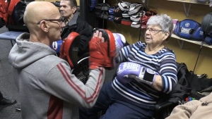 97-year-old Alleyne Huggard, right, seen boxing as part of a new program in New Brunswick.