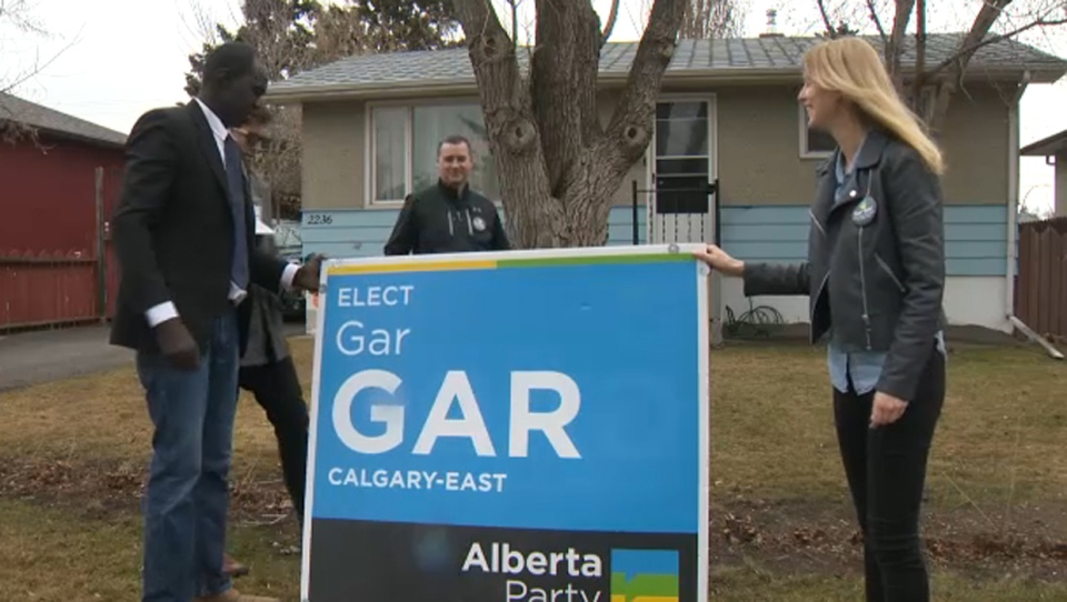 A Calgary couple asked for a larger Gar Gar campaign sign after hearing of a landlord-tenant dispute that saw one of Gar's signs destroyed