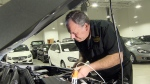 Dale Finch with Titan Certified takes engine oil and transmission fluid samples for analysis.