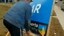 Man damaging Gar Gar campaign sign