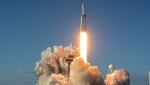 A SpaceX Falcon Heavy rocket carrying a communication satellite lifts off from pad 39A at the Kennedy Space Center in Cape Canaveral, Fla., Thursday, April 11, 2019. (Craig Bailey/Florida Today via AP)