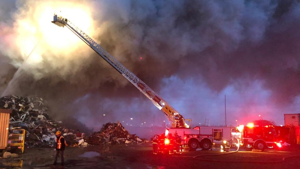 Fire crews fight a fire at a metal scrap yard on Intermodal Drive in Brampton on April 11, 2019. (Bill Boyes/Brampton Fire)