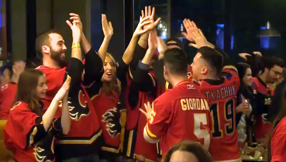 Flames fans celebrate a 4 - 0 win over the Colorado Avalanche on Wednesday night.