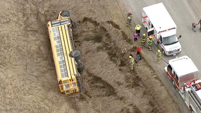 Police and firefighter on scene in rural Durham Region where a school bus rolled over on April 12, 2019.