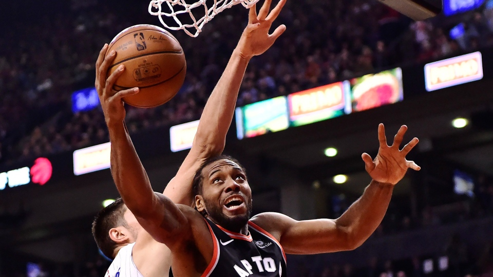 Toronto Raptors forward Kawhi Leonard (2) is fouled by Orlando Magic centre Nikola Vucevic (9) during first half NBA basketball action in Toronto on Monday, April 1, 2019. The Toronto Raptors are about to tip off perhaps the most-anticipated post-season run in franchise history. The Raptors rebuilt with a long playoff run in mind, but can't look past the Orlando Magic, who handed Toronto two of their ugliest losses of the regular season.THE CANADIAN PRESS/Frank Gunn