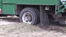Rear wheels of a dump truck in the dirt