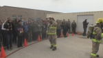 The Tiny Township Fire Department, with assistance from shop students at Ecole Secondaire Le Caron who created seven replica home burn boxes, demonstrate fire and burn patterns generated from structure fires.