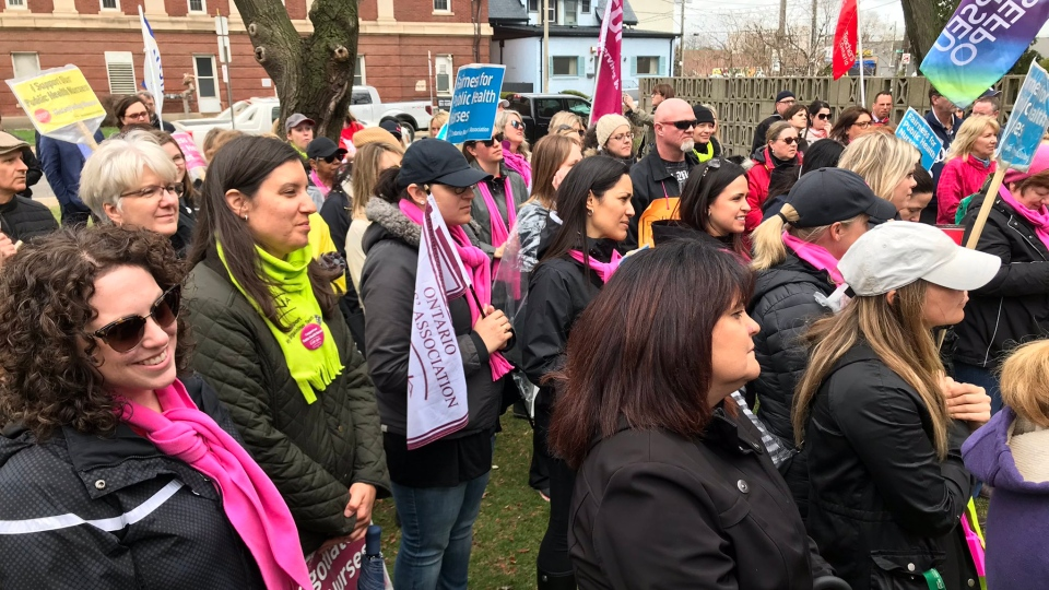 Striking nurses and supporters rally outside of the Windsor-Essex County Health Unit in Windsor, Ont., on Friday, April 12, 2019. (Alana Hadadean / CTV Windsor)