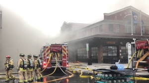 Crews battle a large fire in Ottawa's ByWard Market, Friday, April 12, 2019. (Meghan Shaw / CTV News)