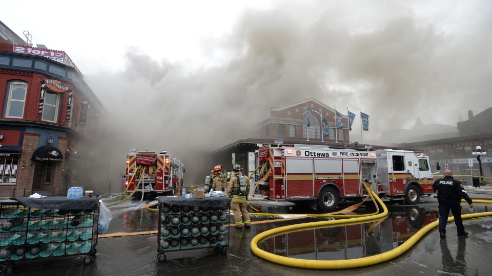 Firefighters battle a blaze at the Byward Market in Ottawa, Friday, April 12, 2019. THE CANADIAN PRESS/Sean Kilpatrick