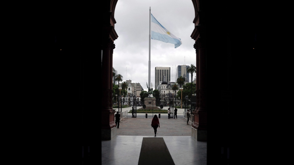 File photo: An Argentine flag waves over Plaza de Mayo square, in Buenos Aires, Argentina, Thursday, Nov. 29, 2018 (AP Photo/Natacha Pisarenko)