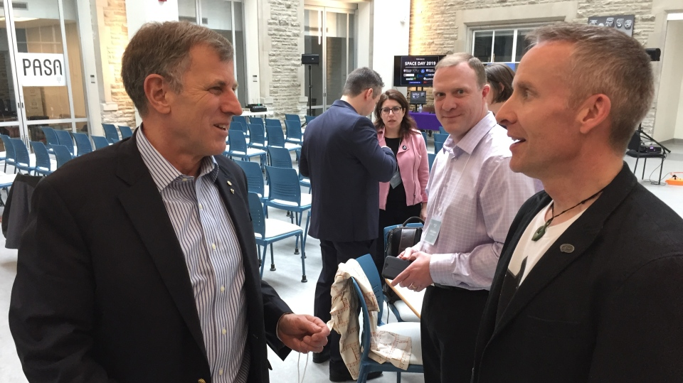 Canadian astronaut Dave Williams, left, visits Western University for Space Day in London, Ont. on Friday, April 12, 2019. (Bryan Bicknell / CTV London)