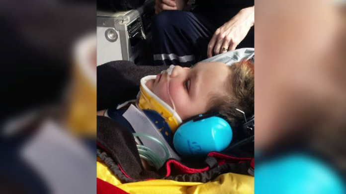Andrew Corneilse, 11, being airlifted to hospital. (Source: Drew Haller)
