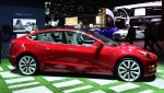 The electric car maker plans to keep taking online orders for the Standard Plus Model 3, which starts at $39,500. (Frederic J. BROWN / AFP)