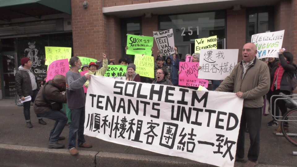Residents of Solheim Place protested in front of their home, demanding the landlord fix their elevator,