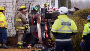 Members of the Kentville Fire Department work to extricate the driver and passengers from a car that collided with a home on Sherman Belcher Road in Centreville, N.S. on Saturday morning. (COURTESY BILL ROBERTS)