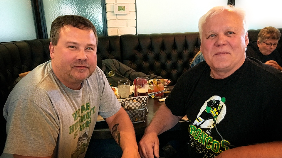 Scott and Frank Thomas enjoying the pre-game meal ahead of Evan Thomas Day in Saskatoon.