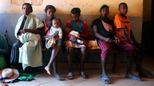 In this photo taken Thursday, March 21, 2019, mothers wait to have their babies vaccinated against measles, at a healthcare center in Larintsena, Madagascar. (AP Photo/Laetitia Bezain)