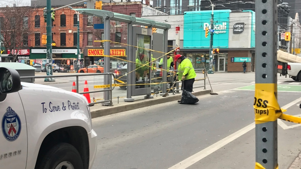 Police investigate a hit-and-run collision at a transit shelter at College Street and Spadina Avenue Sunday April 14, 2019. (Brandon Gonez /CP24)
