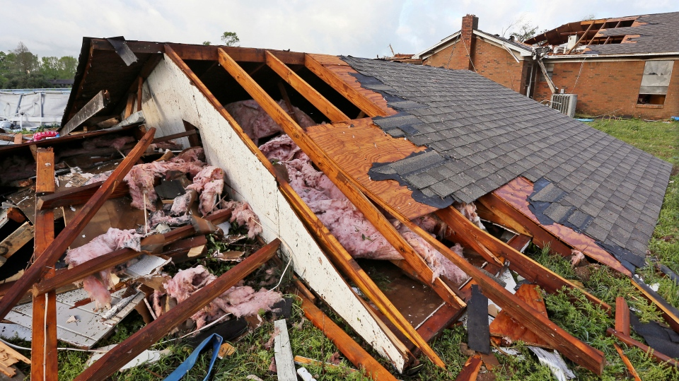 A roof that was blown off a home rests on the ground in Hamilton, Miss., after a deadly storm moved through the area Sunday, April 14, 2019. (AP Photo/Jim Lytle)