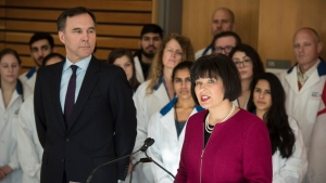 Ginette Petitpas Taylor, federal Minister of Health, right, speaks as Bill Morneau, Minister of Finance, listens during a press conference on the national pharmacare program at the Li Ka Shing Knowledge Institute in Toronto on Wednesday, March 6, 2019. THE CANADIAN PRESS/ Tijana Martin