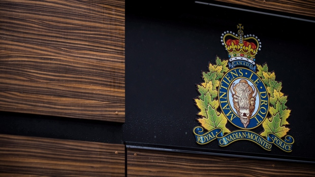 """The RCMP logo is seen outside Royal Canadian Mounted Police """"E"""" Division Headquarters, in Surrey, B.C., on Friday April 13, 2018. THE CANADIAN PRESS/Darryl Dyck"""