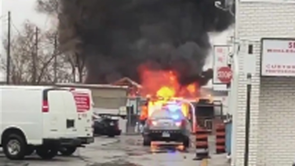 Flames are visible at a warehouse near Steeles and Midland avenues Sunday April 14, 2019. (@winter_shaman /CP24)