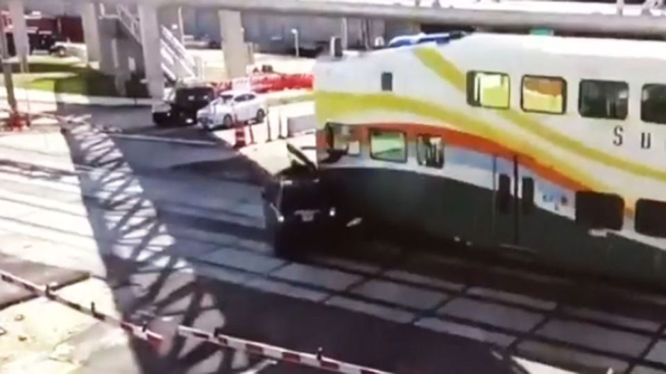 This still, taken from a video released by Orlando Police, shows the moment a SunRail train plowed into an SUV after it had driven under a closing railway barrier. (Orlando Police via Storyful)