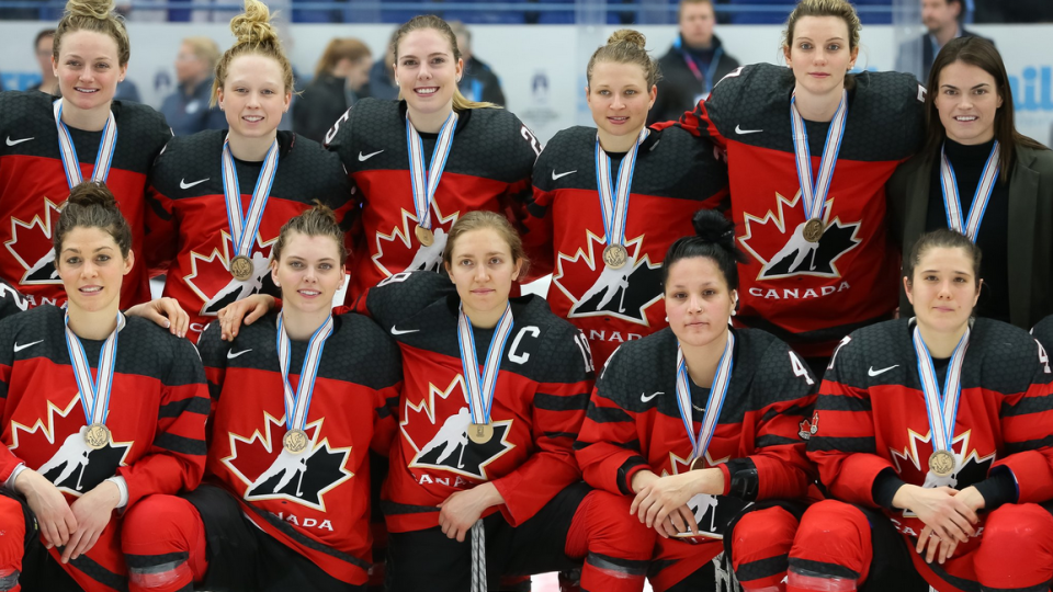 Canada's women's hockey team with their gold medals in Finland.